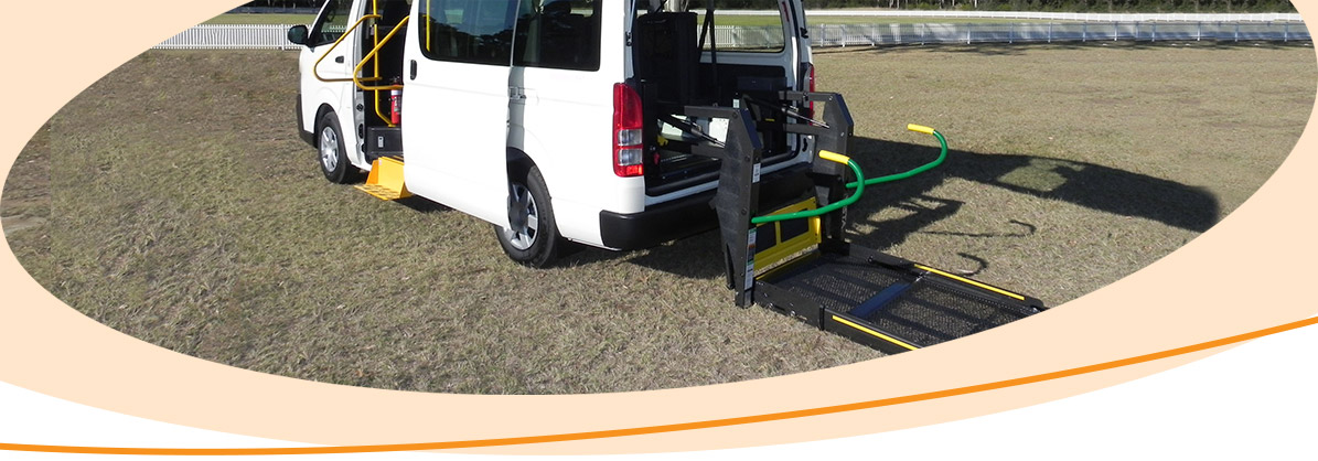 Converted van with side disablility access modifications and rear wheelchair access hoist